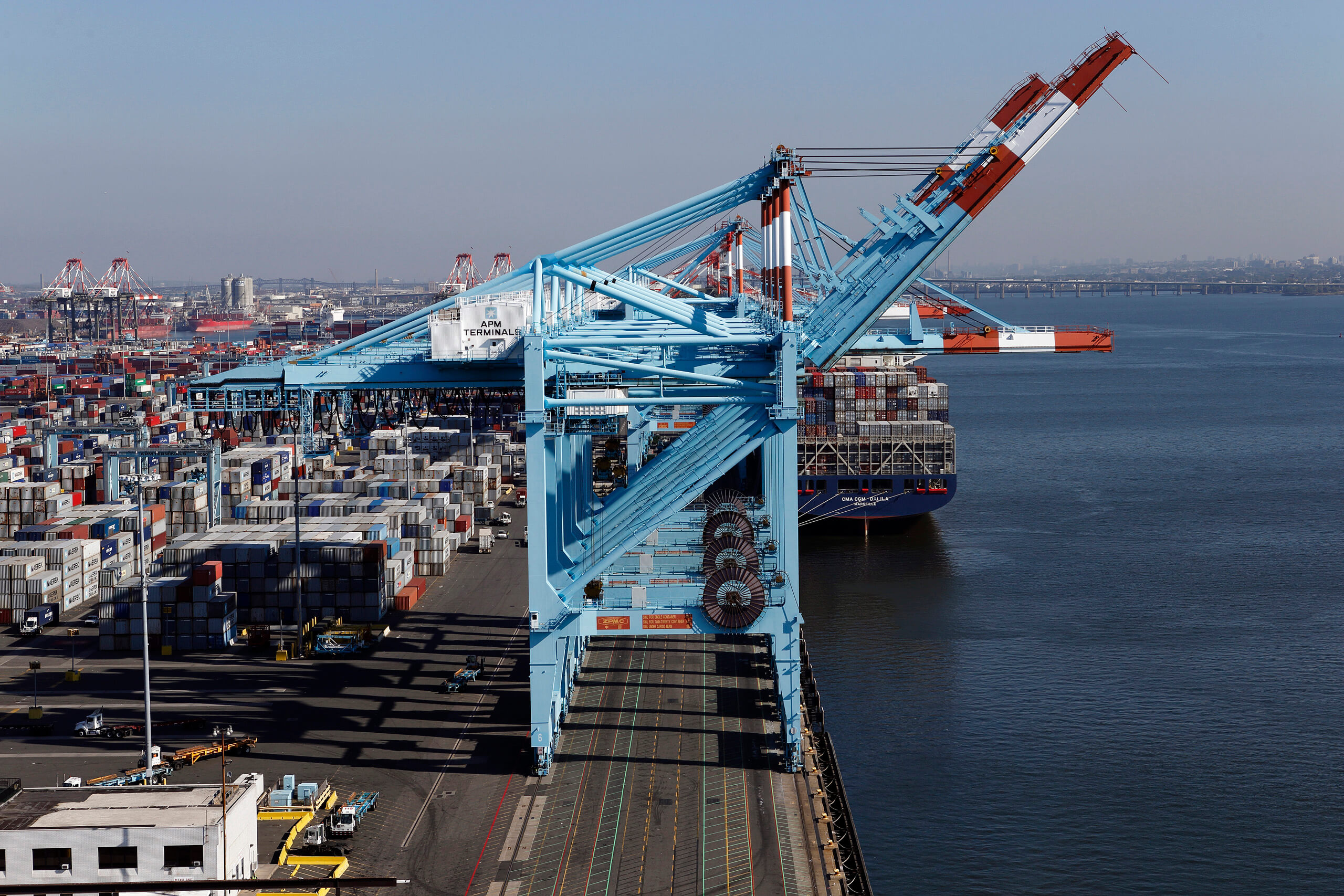 Aerial photo of a blue cargo-freight crane in Port of Newark, NJ at APM Terminals.
