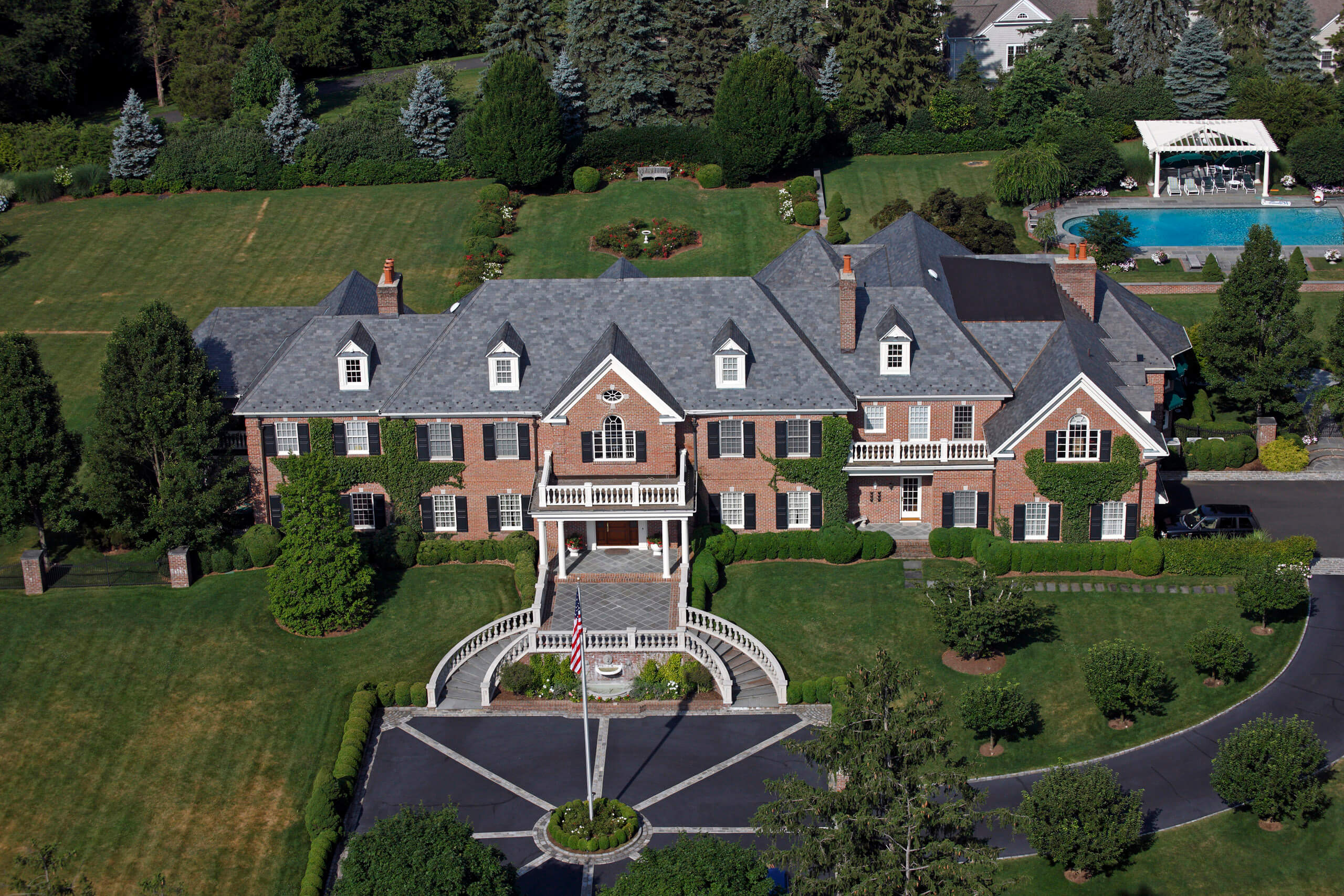Aerial photo of residential real estate featuring Tommy Hilfiger's private mansion home in Greenwich CT
